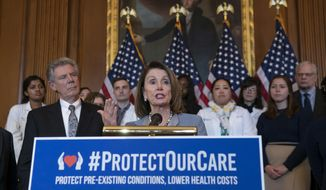 In this March 26, 2019, file photo, Speaker of the House Nancy Pelosi, D-Calif., joined at left by Energy and Commerce Committee Chair Frank Pallone, D-N.J., speaks at an event to announce legislation to lower health care costs and protect people with pre-existing medical conditions, at the Capitol in Washington. (AP Photo/J. Scott Applewhite) ** FILE **