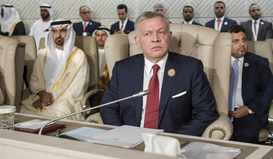Jordan's King Abdullah II attends the opening of the 30th Arab Summit in Tunis, Tunisia, Sunday, March 31, 2019. Leaders meeting in Tunisia for the annual Arab League summit on Sunday were united in their condemnation of Trump administration policies seen as unfairly biased toward Israel but divided on a host of other issues, including whether to readmit founding member Syria. (Fethi Belaid/ Pool photo via AP)