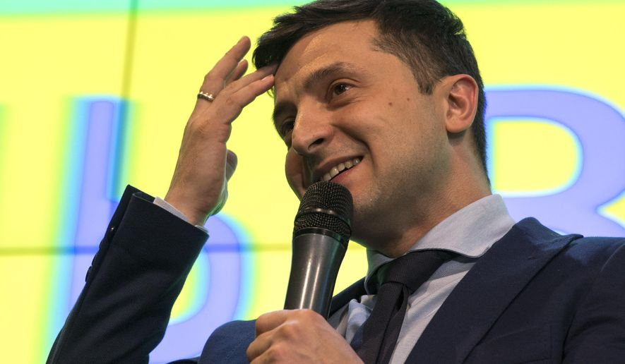 Ukrainian comedian Volodymyr Zelenskiy, reacts as he responds to a journalist question during a press conference, after the presidential elections in Kiev, Ukraine, Sunday, March. 31, 2019. Exit polls indicated Zelenskiy would get about 30 percent of the vote, far short of the absolute majority needed to win the first round. Most exit polls said incumbent Petro Poroshenko received the second-biggest support, which would put him and Zelenskiy in a runoff on April 21. (AP Photo/Emilio Morenatti)