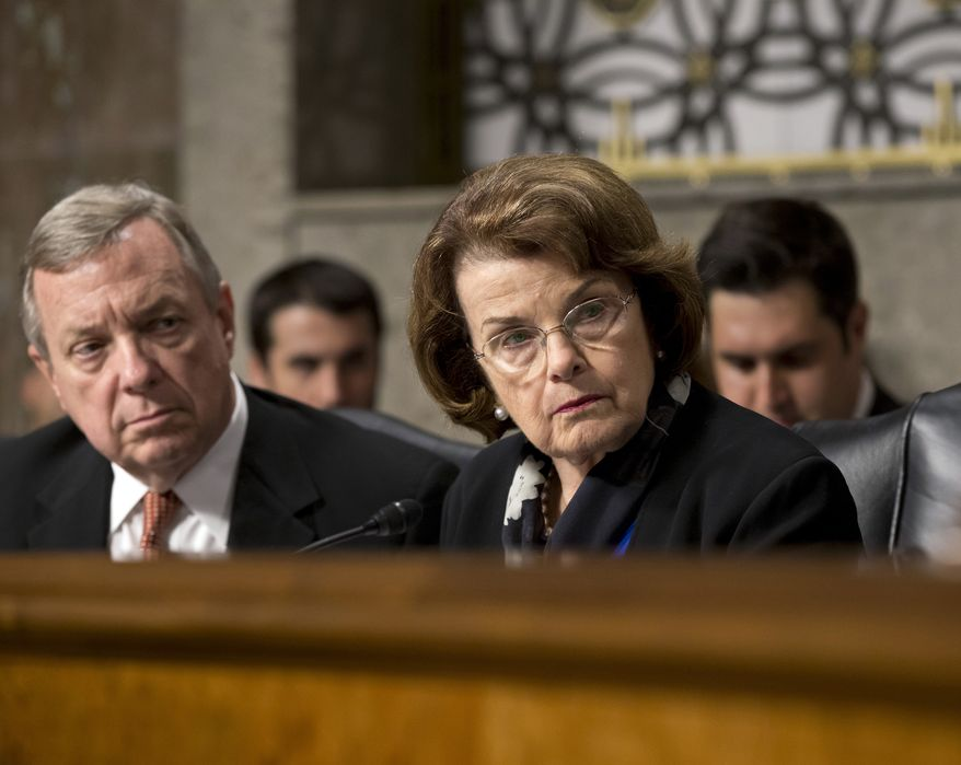 "FILE - In this June 12, 2013, file photo, Sen. Dianne Feinstein, D-Calif., right, chair of the Senate Intelligence Committee, and Sen. Dick Durbin, D-Ill., listen to testimony from Gen. Keith B. Alexander, director of the National Security Agency and head of the U.S. Cyber Command before the Senate Appropriations Committee. U.S. authorities have said they are reducing the amount of time they will delay deporting the few immigrants in the country illegally awaiting congressional decisions to legalize their immigration status after lawmakers file so-called ""private bills"" supporting their last-ditch bids to remain in the country. Senators Durbin and Feinstein criticized the decision to change longstanding practices they said was made without consulting lawmakers. (AP Photo/J. Scott Applewhite, File)"