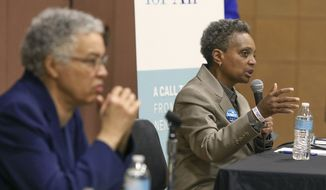 In this March 24, 2019, photo, Chicago mayoral candidate Lori Lightfoot, right, participates in a candidate forum in Chicago. Lightfoot and Toni Preckwinkle, left, are competing to make history by becoming the city's first black, female mayor. On issues their positions are similar. But their resumes are not, and that may make all the difference when voters pick a new mayor on Tuesday, April 2, 2019. (AP Photo/Teresa Crawford)