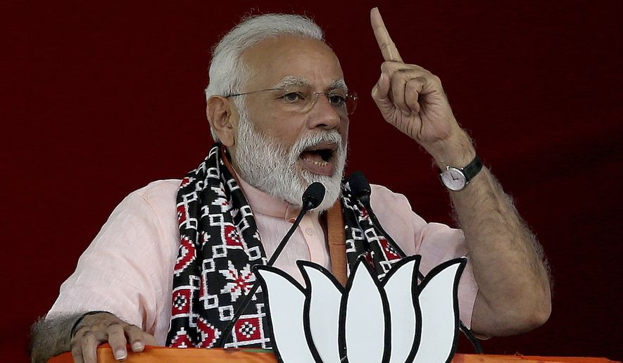 Indian Prime Minister Narendra Modi speaks during an election campaign rally of his Bharatiya Janata Party (BJP) in Hyderabad, India, Monday, April 1, 2019. India's general elections will be held in seven phases starting April 11. (AP Photo/Anupam Nath)