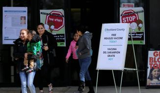 Sign advertising free measles vaccines and information about measles are displayed at the Rockland County Health Department in Pomona, N.Y., Wednesday, March 27, 2019. The county in New York City's northern suburbs declared a local state of emergency Tuesday over a measles outbreak that has infected more than 150 people since last fall, hoping a ban against unvaccinated children in public places wakes their parents to the seriousness of the problem. (AP Photo/Seth Wenig)