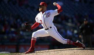 Washington Nationals relief pitcher Sean Doolittle (63) delivers a pitch during a baseball game against the New York Mets, Sunday, March 31, 2019, in Washington. The Nationals won 6-5.(AP Photo/Nick Wass)