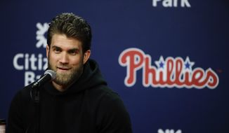 In this March 26, 2019 photo, Philadelphia Phillies' Bryce Harper speaks during a news conference in Philadelphia. (AP Photo/Matt Rourke)