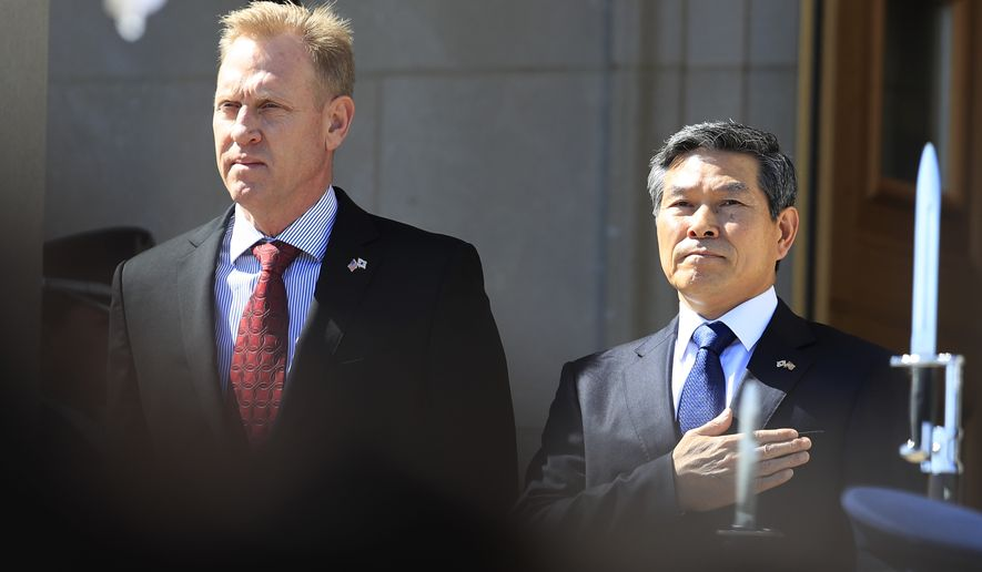 Acting Secretary of Defense Patrick Shanahan welcomes South Korean National Defense Minister Jeong Kyeong-doo, during a ceremony at the Pentagon in Washington, Monday, April 1, 2019. (AP Photo/Manuel Balce Ceneta)