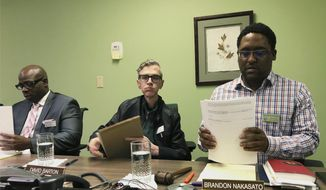 "Alaska Human Rights Commission members Marcus Sanders, left, David Barton, middle, and chairman Brandon Nakasato are shown at the conclusion of a commission meeting Monday, April 1, 2019, in Anchorage, Alaska. The commission went into executive session for nearly three hours but recessed when it could not come to a conclusion on the fate of Marti Buscaglia, its executive director after Alaska Gov. Mike Dunleavy requested an investigation following her social media complaint about a pickup parked in the commission's lot that had a ""Black Rifles Matter"" sticker. (AP Photo/Mark Thiessen)"