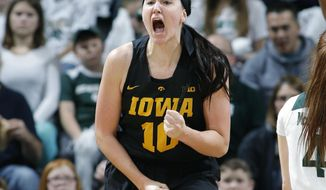 FILE - In this Dec. 30, 2018, file photo, Iowa's Megan Gustafson (10) reacts against Michigan State during an NCAA college basketball game, in East Lansing, Mich. Gustafson, who averaged a Division I-best 28 points while also ranking second in rebounding, was selected to The Associated Press women's All-America first team, Monday, April 1, 2019. (AP Photo/Al Goldis, File)