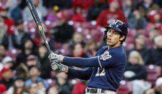 Milwaukee Brewers' Christian Yelich reacts to a swinging strike against Cincinnati Reds starting pitcher Tanner Roark in the second inning of a baseball game, Monday, April 1, 2019, in Cincinnati. (AP Photo/John Minchillo)
