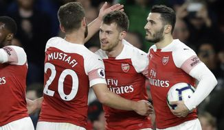 Arsenal's Aaron Ramsey, center, celebrates scores his side's first goal during the English Premier League soccer match between Arsenal and Newcastle United at Emirates stadium in London, Monday, April 1, 2019. (AP Photo/Kirsty Wigglesworth)
