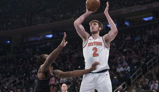 New York Knicks forward Luke Kornet (2) goes to the basket against Chicago Bulls forward JaKarr Sampson (14) during the first half of an NBA basketball game, Monday, April 1, 2019, at Madison Square Garden in New York. (AP Photo/Mary Altaffer)