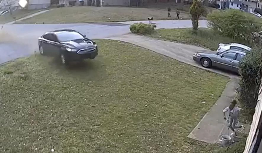 In this video frame grab made available by attorney Chris Stewart, shows a speeding car out of control before it hits LaDerihanna Holmes, 9, as she plays in her front yard Friday, March 29, 2019 in Lithonia, Ga. The driver is still at large. (Chris Stewart via AP)