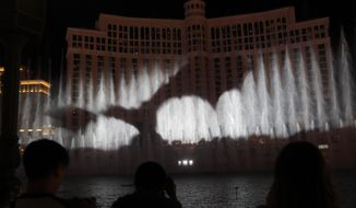 """A dragon is projected during a """"Game of Thrones""""-themed show at the fountains at the Bellagio casino-resort, Sunday, March 31, 2019, in Las Vegas. (AP Photo/John Locher)"""