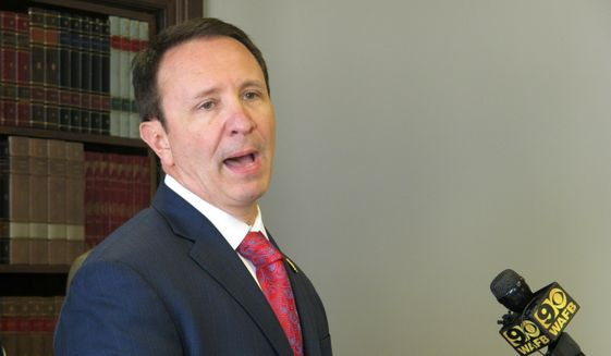 Attorney General Jeff Landry talks about health care legislation he's backing in the upcoming session, on Monday, April 1, 2019, in Baton Rouge, La. Landry, a Republican, and Democratic Gov. John Bel Edwards are pushing dueling bills aimed at protecting people with pre-existing health conditions if the federal Affordable Care Act is overturned. (AP Photo/Melinda Deslatte)