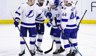 Tampa Bay Lightning center Yanni Gourde (37) celebrates a goal with teammates while taking on the Ottawa Senators during first-period NHL hockey game action in Ottawa, Ontario, Monday, April 1, 2019. (Sean Kilpatrick/The Canadian Press via AP)