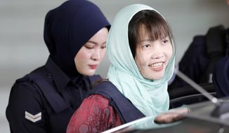 Vietnamese Doan Thi Huong, right, leaves Shah Alam High Court in Shah Alam, Malaysia, Monday, April 1, 2019. The Vietnamese woman who is the only suspect in custody for the killing of the North Korean leader's brother Kim Jong Nam pleaded guilty to a lesser charge in a Malaysian court on Monday and her lawyer said she could be freed as early as next month. (AP Photo/Vincent Thian)