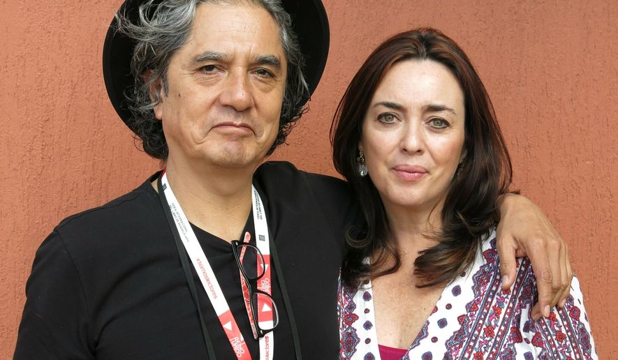 FILE - In this Dec. 5, 2015 file photo, Mexican musician Armando Vega Gil, left, and author Beatriz Rivas pose for a portrait during the Guadalajara International Book Fair in Guadalajara, Mexico. The Mexican rock band Botellita de Jerez announced on Monday, April 1, 2019 the death of its founder Armando Vega Gil. The musician and writer had posted a message announcing his suicide.  (AP Photo/Berenice Bautista, File)