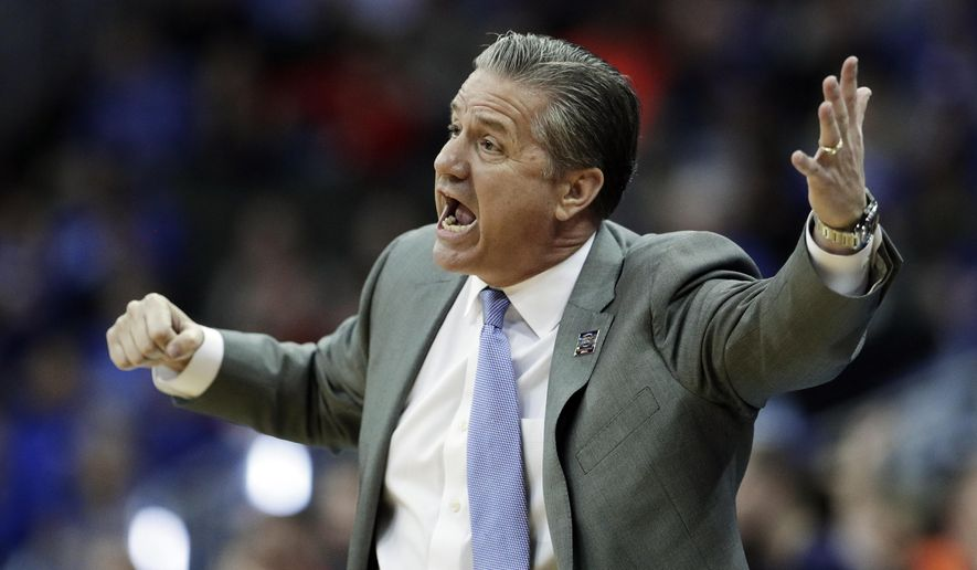Kentucky head coach John Calipari yells to his players during the first half of the Midwest Regional final game against Auburn in the NCAA men's college basketball tournament Sunday, March 31, 2019, in Kansas City, Mo. (AP Photo/Charlie Riedel)