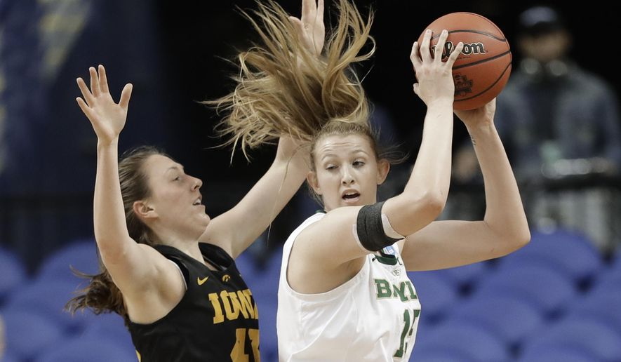 Baylor's Lauren Cox, right, drives against Iowa's Amanda Ollinger, left, during the first half of a regional final women's college basketball game in the NCAA Tournament in Greensboro, N.C., Monday, April 1, 2019. (AP Photo/Chuck Burton)