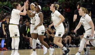Notre Dame's Jackie Young (5) celebrates with her teammates after scoring a basket during the second half of a regional championship game against Stanford in the NCAA women's college basketball tournament, Monday, April 1, 2019, in Chicago. (AP Photo/Nam Y. Huh)
