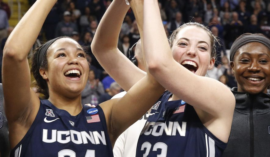 Connecticut forward Napheesa Collier (24) and guard Katie Lou Samuelson (33) hold up the trophy after defeating Louisville in a regional championship final in the NCAA women's college basketball tournament, Sunday, March 31, 2019, in Albany, N.Y. (AP Photo/Kathy Willens) **FILE**