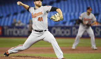 Baltimore Orioles starting pitcher David Hess (41) works against the Toronto Blue Jays during first-inning baseball game action in Toronto, Monday, April 1, 2019. (Nathan Denette/The Canadian Press via AP)