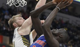 Detroit Pistons' Thon Maker (7) is fouled by Indiana Pacers' Domantas Sabonis (11) as he goes up for a shot during the first half of an NBA basketball game, Monday, April 1, 2019, in Indianapolis. (AP Photo/Darron Cummings)