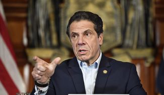 New York Gov. Andrew Cuomo speaks about the $175.5 billion state budget during a news conference in the Red Room at the state Capitol Sunday, March, 31, 2019, in Albany, N.Y. (AP Photo/Hans Pennink) ** FILE **