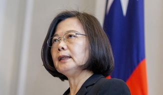 In this photo released by the Taiwan Presidential Office, Taiwanese President Tsai Ing-wen speaks during a military award ceremony at the Presidential office in Taipei, Taiwan on Monday, April 1, 2019. Taiwan said Monday its planes warned off Chinese military aircraft that crossed the center line in the Taiwan Strait, and called China's move a provocation that seeks to alter the status quo in the waterway dividing the island from mainland China. (Taiwan Presidential Office via AP)