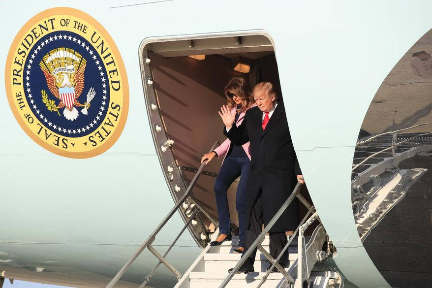 President Donald Trump and first lady Melania Trump disembark Air Force One upon arrival at Andrews Air Force Base, Md., Sunday, March 31, 2019. (AP Photo/Manuel Balce Ceneta)