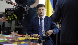 """FILE - In this file photo taken on Wednesday, Feb. 6, 2019, Ukrainian comedian Volodymyr Zelenskiy, who played the nation's president in a popular TV series, is photographed on the film set in Kiev, Ukraine.   Zelenskiy has no political experience, but his easygoing manner and snappy talk on the campaign trail strongly resembled his character in """"Servant of the People"""", a schoolteacher catapulted into the presidential seat. (AP Photo/Efrem Lukatsky, File)"""