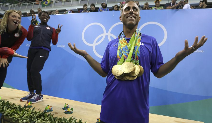 FILE - In this Friday, Aug. 19, 2016, file photo, United States' women's water polo head coach Adam Krikorian poses for photographers during the medals ceremony at the Summer Olympics in Rio de Janeiro, Brazil. Krikorian coached the U.S. to the 2009 world title. (AP Photo/Sergei Grits, File)