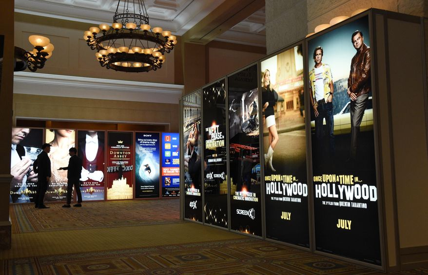 """Advertisements for upcoming films including writer/director Quentin Tarantino's """"Once Upon a Time in Hollywood,"""" right, decorate a hallway of Caesars Palace on the first day of CinemaCon 2019, the official convention of the National Association of Theatre Owners (NATO), Monday, April 1, 2019, in Las Vegas. (Photo by Chris Pizzello/Invision/AP)"""