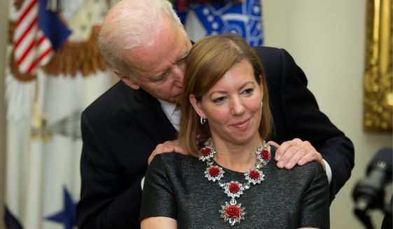 There are tons of photos of former Vice President Joseph R. Biden laying his hands on women, including this one from 2015, where he rubs Stephanie Carter's shoulders. (Associated Press)