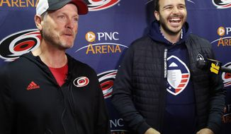 FILE - In this Feb. 19, 2019, file photo, Tom Dundon, left, majority owner of the Carolina Hurricanes, and Charlie Ebersol, co-founder and CEO of the Alliance of American Football, talk to the media in Raleigh, N.C. The Alliance of American Football is suspending operations eight games into its first season. A person with knowledge of the decision tells The Associated Press the eight-team spring football league is not folding, but games will not be played this weekend. The decision was made by majority owner Tom Dundon. The person spoke to The Associated Press on condition of anonymity because league officials were still working through details of the suspension. An announcement from the league is expected later Tuesday, April 2, 2019. (AP Photo/Chris Seward) ** FILE **