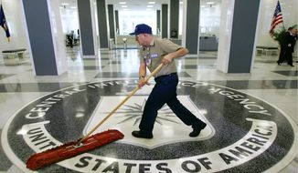 """In this March 3, 2005, file photo, a workman dusts the floor at the Central Intelligence Agency headquarters in Langley, Va. The American Civil Liberties Union has filed a lawsuit challenging a pre-publication review required for people who have had access to government secrets. The CIA says the pre-publication review is necessary to protect national security and protect former employees from legal liability. Timothy Barrett, a CIA spokesman, said the agency does not comment on pending litigation."""" (AP Photo/J. Scott Applewhite, File) **FILE**"""