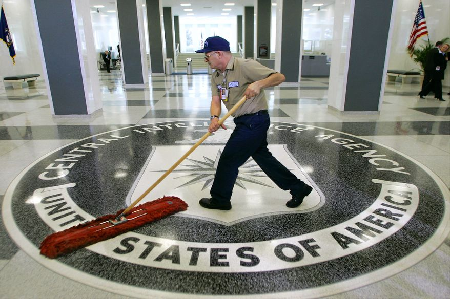 "In this March 3, 2005, file photo, a workman dusts the floor at the Central Intelligence Agency headquarters in Langley, Va. The American Civil Liberties Union has filed a lawsuit challenging a pre-publication review required for people who have had access to government secrets. The CIA says the pre-publication review is necessary to protect national security and protect former employees from legal liability. Timothy Barrett, a CIA spokesman, said the agency does not comment on pending litigation."" (AP Photo/J. Scott Applewhite, File) **FILE**"