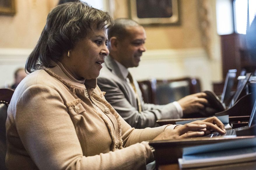Sen. Margie Bright Matthews, D-Colleton, works on a computer in the senate chamber during the first day of legislative session at the South Carolina Statehouse Tuesday, Jan. 10, 2017, in Columbia, S.C. (AP Photo/Sean Rayford)