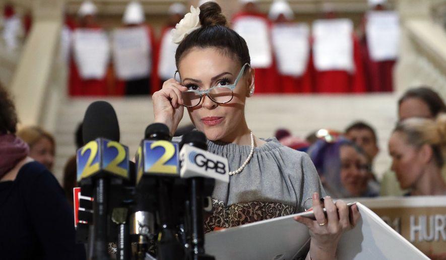 Actress and liberal activist Alyssa Milano is shown in an April 2, 2019, press conference in Atlanta.  (AP Photo/John Bazemore) **FILE**