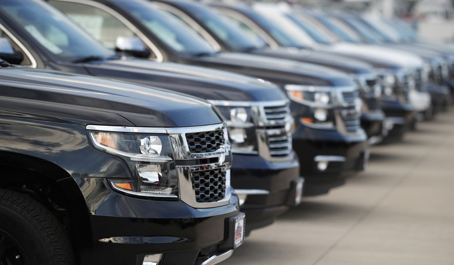 This June 24, 2018, photo shows unsold 2018 Suburbans at a Chevrolet dealership in Englewood, Colo. Automobile sales in the U.S. fell 2% in the first quarter, another sign the nation's economy is starting to slow. (AP Photo/David Zalubowski)