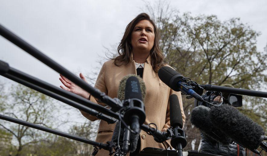 White House press secretary Sarah Sanders talks with reporters outside the White House, Tuesday, April 2, 2019, in Washington. (AP Photo/Evan Vucci)