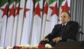 "FILE - In this April 28, 2014 file photo, Algerian President Abdelaziz Bouteflika sits on a wheelchair after taking oath as President, in Algiers. Embattled Algerian President Abdelaziz Bouteflika says he will step down before his fourth term ends on April 28. In a short statement issued on Monday April 1, 2019, the president's office said Bouteflika would take ""important steps to ensure the continuity of the functioning of state institutions"" during a transition period following his departure from the post he's held since 1999. (AP Photo/Sidali Djarboub, File)"