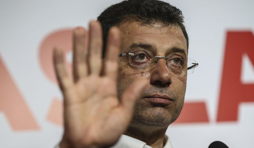 Ekrem Imamoglu, the candidate from an alliance led by the secular Republican People's Party, (CHP) gestures as he declares victory during a news conference in Istanbul, Monday April 1, 2019. Unofficial results by state-run Anadolu news agency said he had won 48.8 percent of the vote Sunday and his opponent, former Prime Minister Binali Yildirim of the ruling party, had captured 48.5 percent. One percent of the votes were still to be counted. (AP Photo/Emrah Gurel)