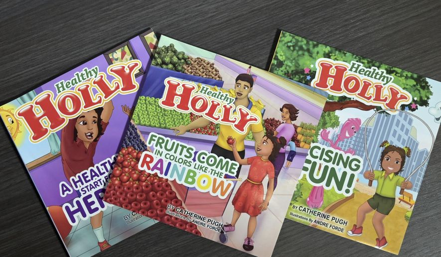 "This March 2019 photo taken in Baltimore, shows copies of then-Baltimore Mayor Catherine Pugh's self-published ""Healthy Holly"" illustrated paperbacks for children. (Jerry Jackson/The Baltimore Sun via AP) ** FILE **"