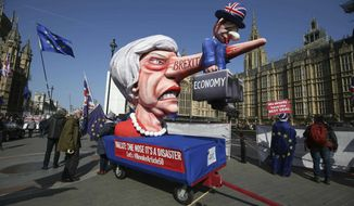Anti-Brexit demonstrators with an effigy of British Prime Minister Theresa May near College Green at the Houses of Parliament in London, Monday, April 1, 2019.  Britain's Parliament gets another chance Monday to offer a way forward on Britain's stalled divorce from the European Union, holding a series of votes on Brexit alternatives in an attempt to find the elusive idea that can command a majority. (Jonathan Brady/PA via AP)