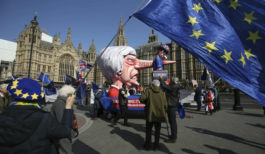 Anti-Brexit demonstrators near College Green at the Houses of Parliament in London, Monday, April 1, 2019.  Britain's Parliament gets another chance Monday to offer a way forward on Britain's stalled divorce from the European Union, holding a series of votes on Brexit alternatives in an attempt to find the elusive idea that can command a majority. (Jonathan Brady/PA via AP)