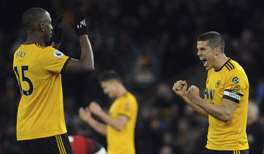 Wolverhampton's Conor Coady, right, and Willy Boly, left, celebrate at the end of the English Premier League soccer match between Wolverhampton Wanderers and Manchester United at the Molineux Stadium in Wolverhampton, England, Tuesday, April 2, 2019. Wolverhampton won 2-1. (AP Photo/Rui Vieira)