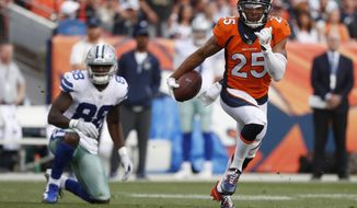 File-This Sept. 17. 2017, file photo shows Denver Broncos cornerback Chris Harris (25) intercepting a pass intended for Dallas Cowboys wide receiver Dez Bryant (88) during the second half of an NFL football game in Denver. Harris skipped the start of the Denver Broncos offseason program Tuesday, April 2, 2019, as he angles for a new contract. The Broncos became the fourth team to start their offseason program, which at this point is voluntary. One of the NFL's most versatile defensive backs, Harris is due $7.8 million next season in the final year of his team friendly, five-year, $42.5 million contract that he signed in 2015. (AP Photo/Jack Dempsey, File)