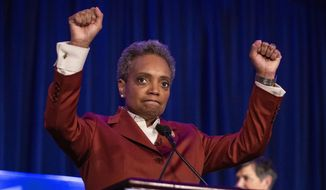 Lori Lightfoot celebrates at her election night rally at the Hilton Chicago after defeating Toni Preckwinkle in the Chicago mayoral election, Tuesday, April 2, 2019. (Ashlee Rezin/Chicago Sun-Times via AP)