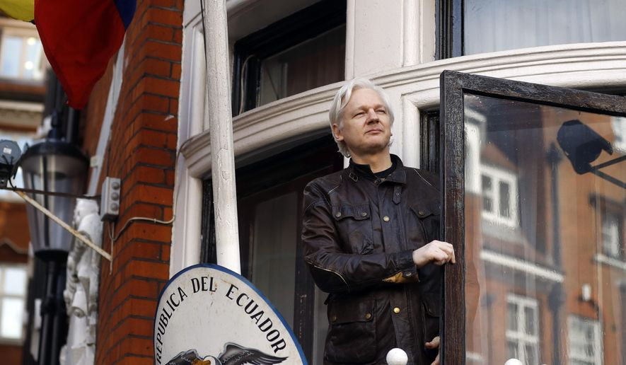 In this Friday, May 19, 2017, file photo, WikiLeaks founder Julian Assange greets supporters outside the Ecuadorian Embassy in London. (AP Photo/Frank Augstein, File)